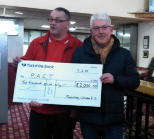 Craig Crapper handing over cheque to Robin Jeeps