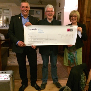 Lady Captain Susan Priest and Gentleman Captain Mark Rabjohn handing over the cheque to Robin Jeeps