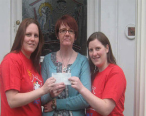 Shura and Claire present cheque to Beryl