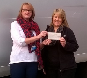 Zoe Bradshaw handing over a cheque to Beryl Welburn