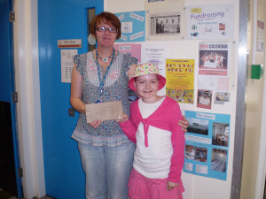 Eve Miller presenting money to Beryl Welburn